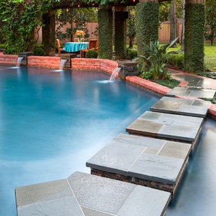 Pool fountain - large eclectic backyard custom-shaped and stone lap pool fountain idea in Houston