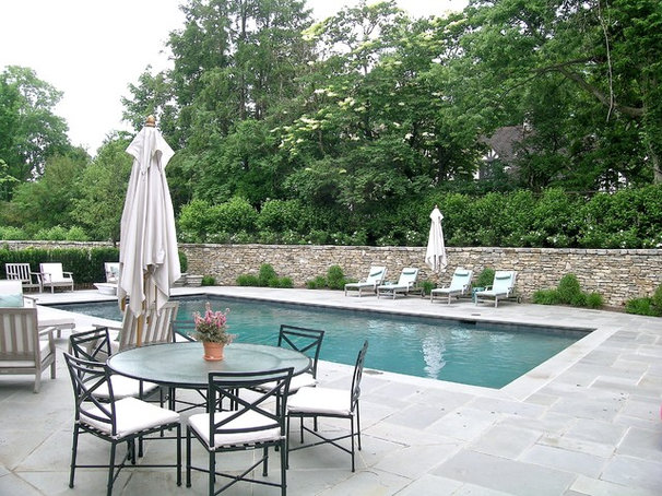 Traditional Pool by RWA Architects
