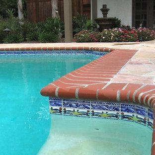 Pool - mid-sized mediterranean backyard stone and rectangular lap pool idea in Sacramento