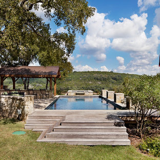 Inspiration for a small arts and crafts rectangular aboveground pool in Austin with a water feature and decking.