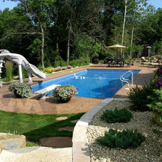 Traditional Pool by Yardmasters Landscapes