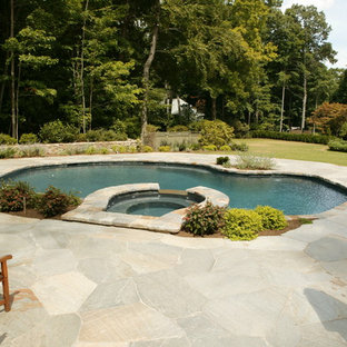 Hot tub - mid-sized traditional backyard stone and custom-shaped natural hot tub idea in New York