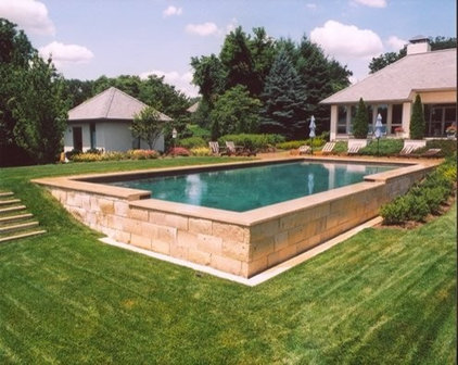 Inground pools for sloped yard for Pool design sloped yard