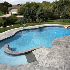 Traditional Pool by Sunset Pools & Spas