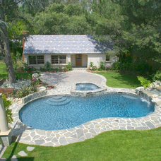 Traditional Pool by Talisse Construction Inc
