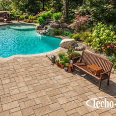 Traditional Pool by Techo-Bloc