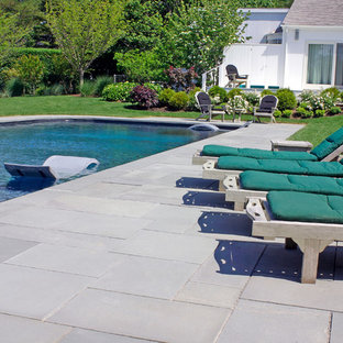 Pool - large traditional backyard stone and rectangular aboveground pool idea in New York