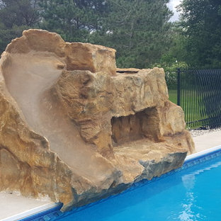 Example of a mid-sized classic backyard concrete paver and rectangular water slide design in Ottawa