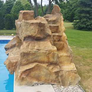 Water slide - mid-sized traditional backyard concrete paver and rectangular water slide idea in Ottawa