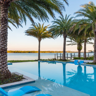 Inspiration for a mediterranean backyard infinity pool remodel in Miami
