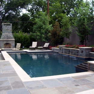 Design ideas for a large transitional backyard rectangular lap pool in Seattle with a water feature and concrete pavers.