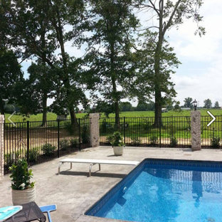 Pool - large traditional backyard concrete and rectangular lap pool idea in Nashville