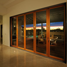 Modern Pool by LaCantina Doors