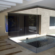 Contemporary Pool by Steve Crawford Construction