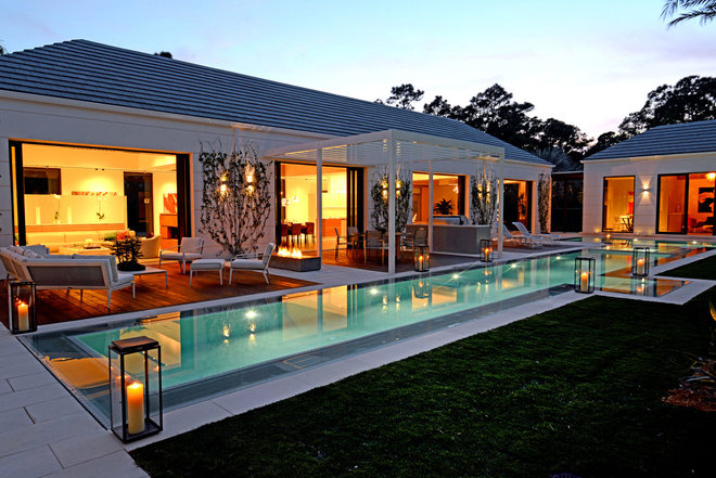 Contemporary Pool by Couture-Homes