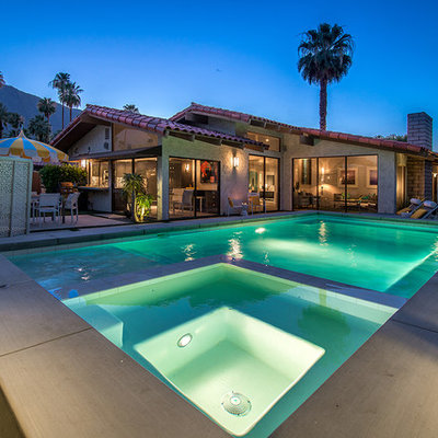 Example of a small 1950s backyard concrete and rectangular pool fountain design in Los Angeles