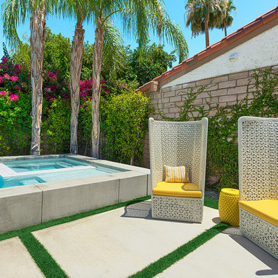 Pool fountain - small mid-century modern backyard concrete and rectangular pool fountain idea in Los Angeles