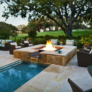 Example of a tuscan backyard stone and rectangular lap pool design in Dallas