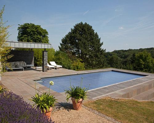 idee fr mittelgroe klassische lap pools hinter dem haus in rechteckiger form mit natursteinplatten in - Pool Design Ideen Bilder