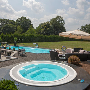 Pool fountain - large contemporary gravel and rectangular lap pool fountain idea in Cologne