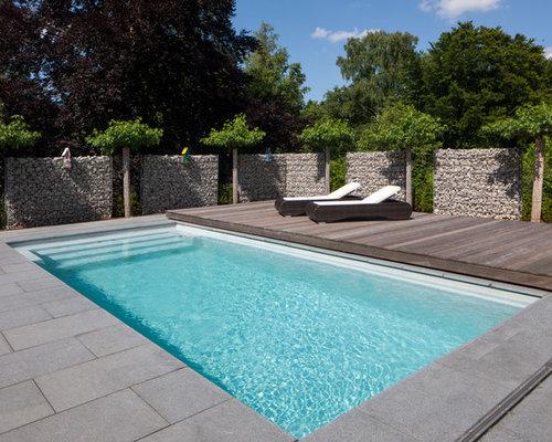 wohnidee fr mittelgroe klassische lap pools hinter dem haus in rechteckiger form mit betonplatten in - Pool Design Ideen Bilder