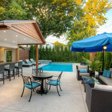 Traditional Pool by Oriole Landscaping Ltd.