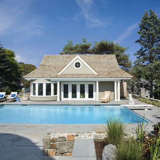 Photo of a traditional rectangular pool in Boston with a pool house.