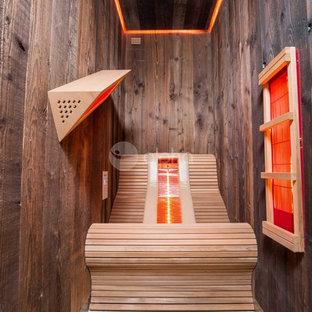 Foto de piscinas y jacuzzis alargados, rurales, grandes, interiores y rectangulares, con adoquines de piedra natural