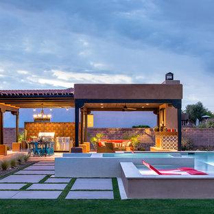 Imagen de piscinas y jacuzzis elevados, de estilo americano, de tamaño medio, rectangulares, en patio trasero, con suelo de baldosas