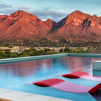 Mid-sized southwest backyard tile and rectangular aboveground hot tub photo in Phoenix