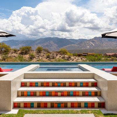 Hot tub - mid-sized southwestern backyard tile and rectangular aboveground hot tub idea in Phoenix