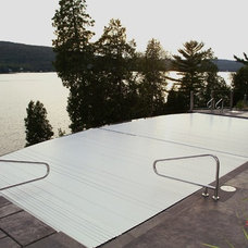 Traditional Pool by Aquamatic Pool Cover Systems