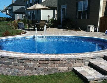 Radiant Round Semi In Ground Pool with Pavers