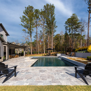 Raised pool with submerged spa and sheer descent water feature