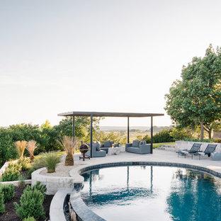 Foto de piscina campestre tipo riñón