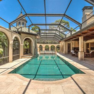 Inspiration for a mediterranean indoor pool house remodel in Tampa