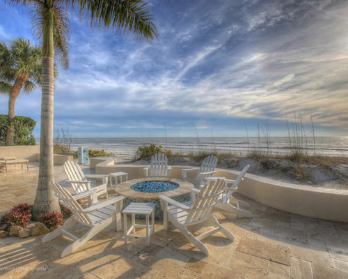 beach style pool design ideas, remodels & photos with brick pavers