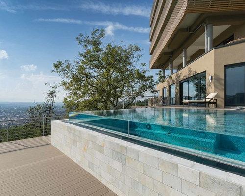 Piscine sur toit avec des pav s en pierre naturelle for Piscine design caluire