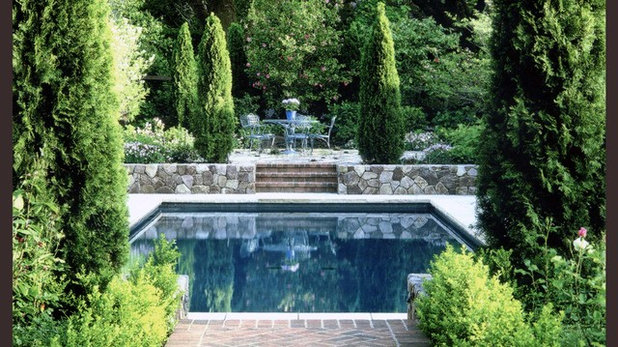Traditional Pool by Strata Landscape Architecture