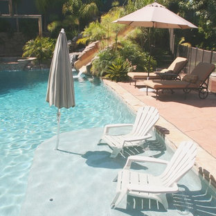 Mid-sized island style backyard stone and custom-shaped lap water slide photo in Los Angeles
