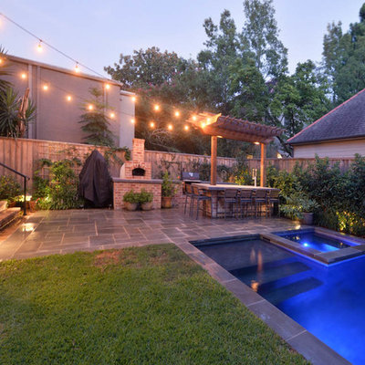 Inspiration for a mid-sized timeless backyard stone and rectangular natural hot tub remodel in New Orleans