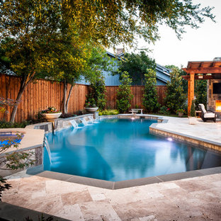 Inspiration for a timeless custom-shaped pool remodel in Dallas