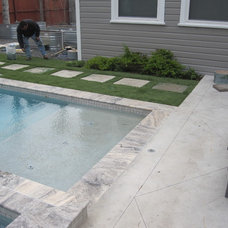 Contemporary Pool by Ravenscourt Landscaping and Design LLC