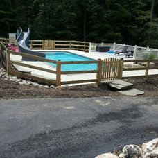 Traditional Pool by Beitzell Fence