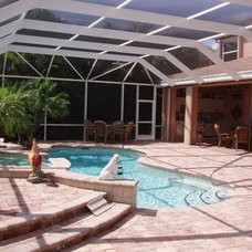 Traditional Pool by Coastal Screen and Rail