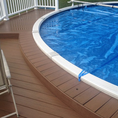 Inspiration for a mid-sized timeless backyard round pool remodel in Detroit with decking