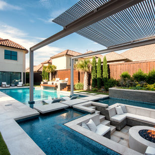 Photo of an expansive modern rectangular swimming pool in Dallas.