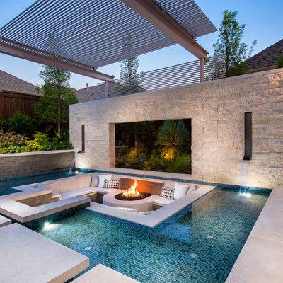 Huge trendy rectangular pool photo in Dallas