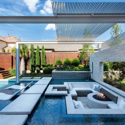 Example of a huge minimalist backyard rectangular pool design in Dallas