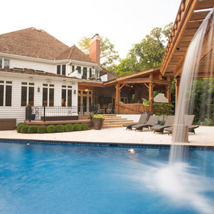This is an example of a large traditional rectangular pool in Chicago with tile.